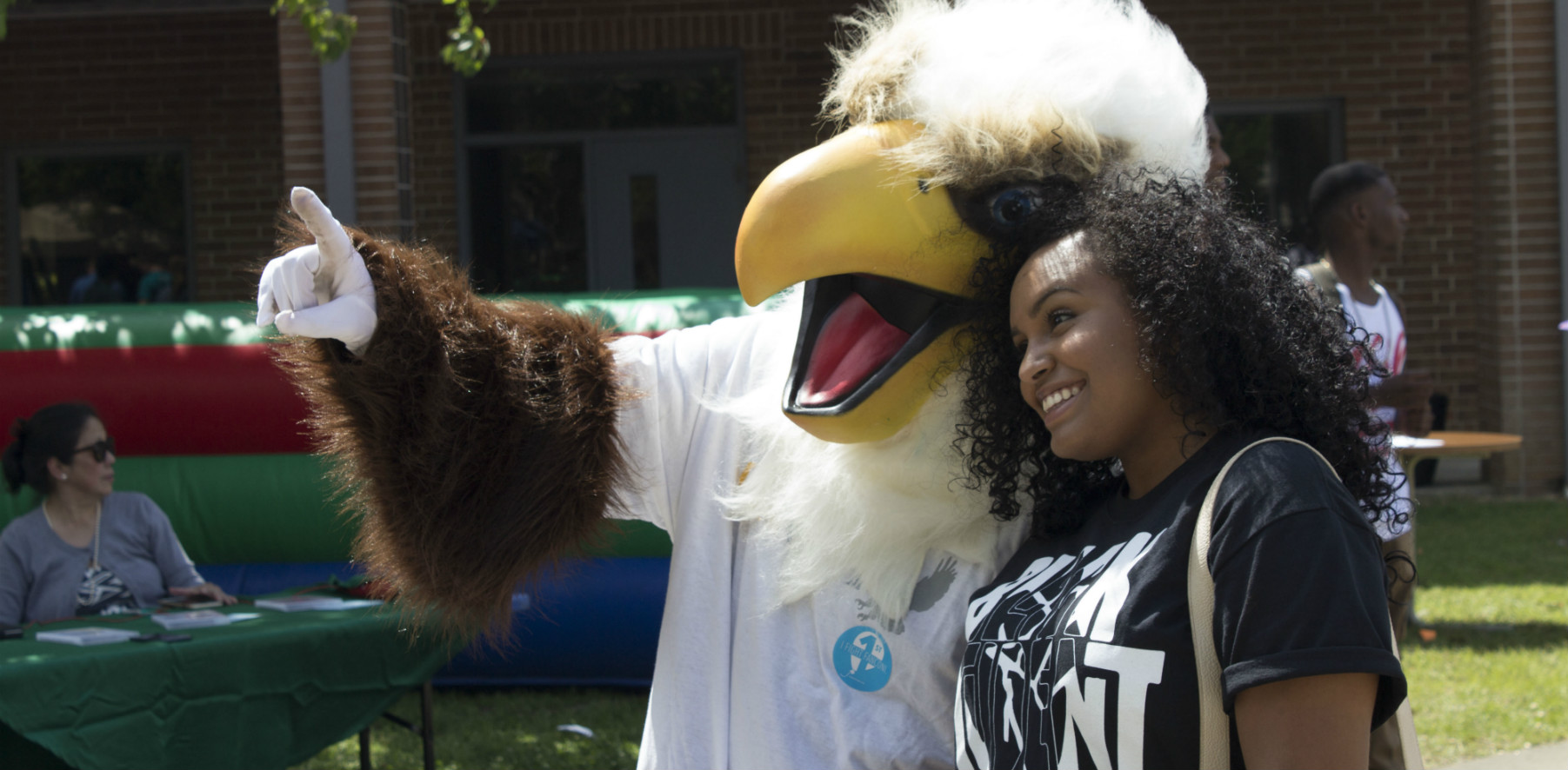 A student takes a photo with the eagle at Stu-Fac Spring 2015