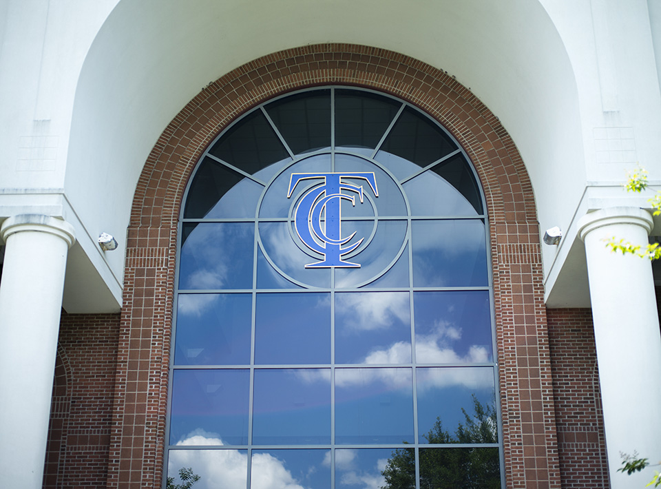 TCC logo on window