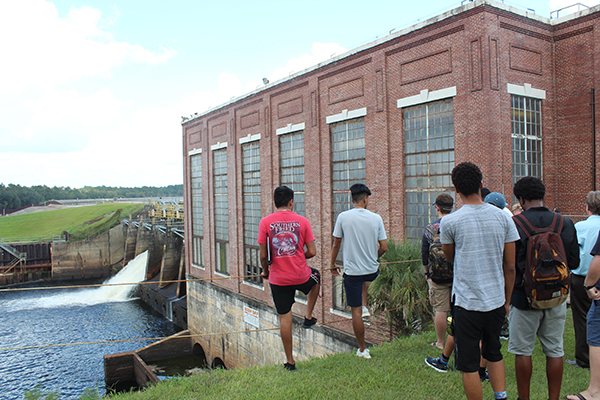 Students viewing dam