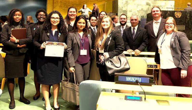 TCC students holding award in U.N. hall