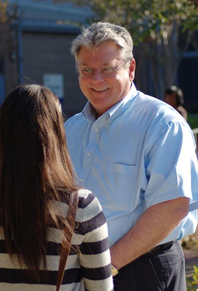 President Jim Murdaugh with a student outside