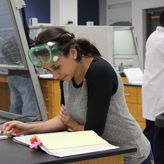 female student studying in a lab