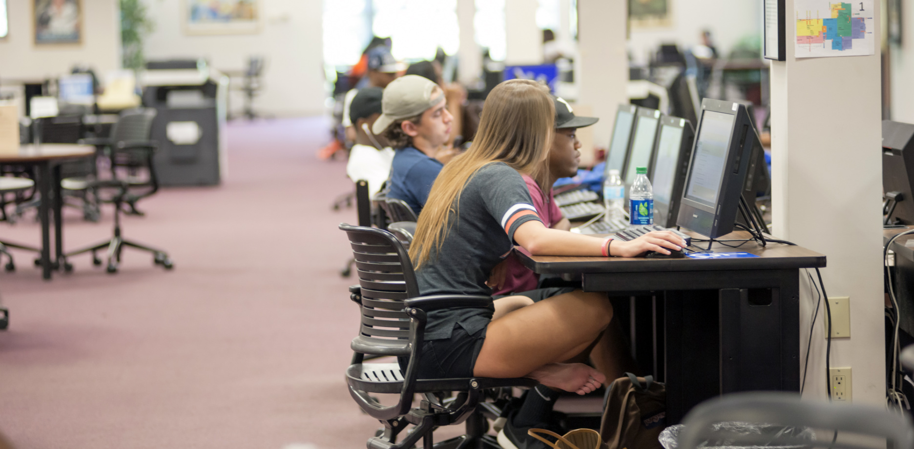 Students study at computers in Library