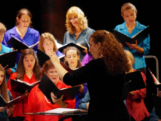 Dr. Leslie Heffner directs the Tallahassee Civic Chorale in a performance.