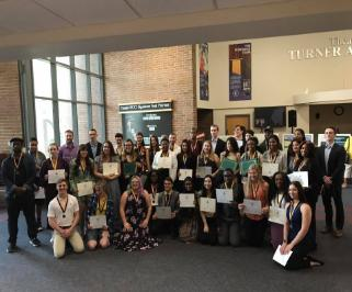 TCC students stand proudly with their awards at the 1st Annual Undergraduate Research Symposium.