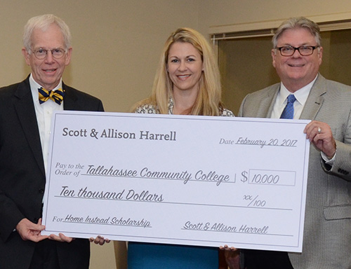 Donor Allison Harrell with TCC officials